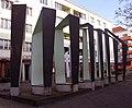 Skulptur Behmstr 11 (Gesbr) Phantom der Lichtburg&Braun Feldweg&2003.jpg