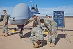 Soldiers from E Company, 160th Special Operations Aviation Regiment (Airborne), explain the capabilities of the MQ-1C Gray Eagle Unmanned Aircraft System at their activation ceremony Nov. 19, 2013..jpg