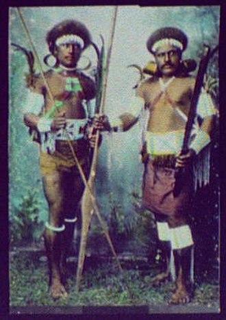 History of Solomon Islands - Two warriors in battle dress (1895)