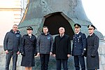 Soyuz MS-11 crew and backup crew in front of the Tsar Bell at the Kremlin.jpg