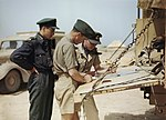 Spitfire pilots of No. 417 Squadron, Royal Canadian Air Force, planning another operation from their airfield at Goubrine in Tunisia, April 1943. TR829.jpg
