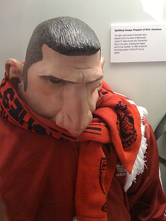 Puppet of Manchester United striker Eric Cantona from the British satirical puppet show Spitting Image Spitting Image Puppet of Eric Cantona (2956625432).jpg