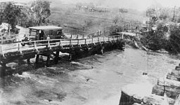 StateLibQld 1 164599 Bus stranded on Old Cleveland Road bridge, Bulimba Creek at Belmont, Brisbane in 1931.jpg
