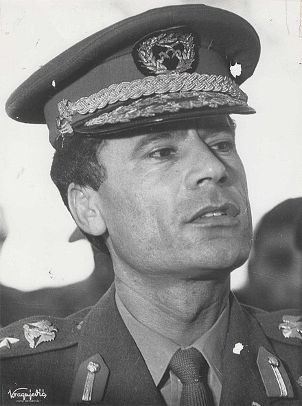 When the Strasserite faction took control of the National Front in the 1980s, it based its views of future government on the ideas in The Green Book of Muammar Gaddafi (pictured). Stevan Kragujevic, Moamer el Gadafi u Beogradu.jpg