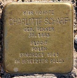 Photo of Charlotte Scharf brass plaque