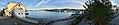 "Stord harbour (hamn) in Leirvik, Stord, Norway. MS ""Tranen"" (ship, 2006, Nordled catamaran ferry) at Nattrutekaien. Evjo, Onarheimsparken, Oma Slipp, Teinevika, Hamnegata, etc. Distorted, compressed panorama 2018-03-10.jpg"