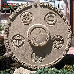 Stone in Straubenhardt, Germany with the emblems of the municipality's formerly autonomous districts
