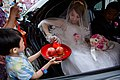 Taiwanese brides taking red envelope out from the red plate.jpg