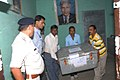 The Electoral Officials carrying the box containing Postal Ballot paper for counting, at a Counting Centre of General Election-2014, in Indore on May 16, 2014.jpg