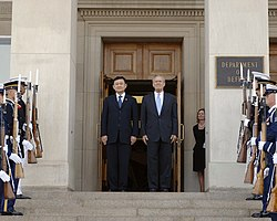 The Honorable Donald H. Rumsfeld (right), U.S. Secretary of Defense, and Thaksin Chinnawat, Thailand Prime Minister, receive military honors at the River Entrance of the Pentagon, Washington DC