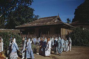 Baju Kurung - Malay women wearing Baju Kurung in Malaya, circa 1950.