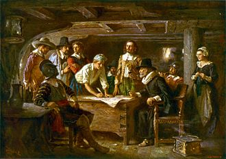 English Americans - The first self-governing document of Plymouth Colony. English Pilgrims signing the Mayflower Compact in 1620.