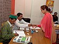 The Polling official administering indelible ink at the finger of a female voter at a polling booth in DAV Sr. Sec. School, Lakkar Bazar, Shimla, during the 5th and final phase of General Election-2009, in Himachal Pradesh.jpg