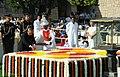 The President, Shri Pranab Mukherjee paying floral tributes at the Samadhi of Mahatma Gandhi on his 144th birth anniversary, at Rajghat, in Delhi. The Union Minister for Urban Development & Parliamentary Affairs.jpg