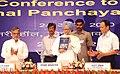 "The Prime Minister, Dr. Manmohan Singh releasing the ""State Panchayats Report 2008-09"", at the National Panchayati Raj Diwas, in New Delhi on April 24, 2010.jpg"