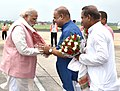 The Prime Minister, Shri Narendra Modi being received on his arrival, at Guwahati Airport on May 27, 2016.jpg