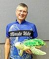 Tim Oey with Olivia, the stuffed sea turtle.jpg