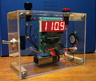 Timer - A simple digital timer. The internal components—including the circuit board with control chip and LED display, a battery, and a buzzer—are visible.