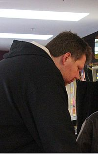 Todd MacCulloch playing pinball cropped.jpg
