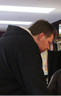 Todd MacCulloch playing pinball cropped.jpg