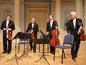 A string quartet. From left to right: violin 1, violin 2, cello, viola