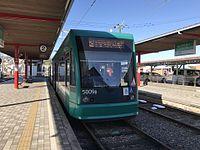 Tramcar for Hiroshima Station at Hiroden-Miyajimaguchi Station.jpg