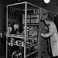 Two mechanics manufacturing a 1 kW medium waves transmitter in Yleisradio's workshop, ca. 1938. (15301368257).jpg