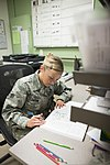 U.S. Air Force Senior Airman Megan Stanton, a medic with the 366th Medical Operations Squadron, studies a medical textbook in the urgent care center at Mountain Home Air Force Base, Idaho, July 15, 2013 130715-F-NW635-099.jpg