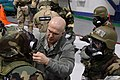 U.S. Air Force Staff Sgt. Mike Dowling, center, with 175th Emergency Management, checks the mission-oriented protective posture gear of Airmen with the 175th Aircraft Maintenance Squadron during ability to 140111-Z-PA115-006.jpg