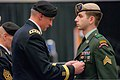 U.S. Army Lt. Gen. Robert B. Brown, left, the commanding general of I Corps, pins the Silver Star to the uniform of Sgt. Peter Cimpoes, assigned to the 2nd Battalion, 75th Ranger Regiment, during a special 130320-A-CD114-826.jpg