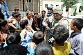 U.S. Army Sgt. 1st Class Thomas Mondares, second from right, with the Kunar Provincial Reconstruction Team civil affairs section, jokes with children at a school in the Narang district, Kunar province 120526-F-NG741-264.jpg