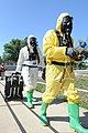 U.S. Army Sgt. Adam Long follows Sgt. 1st Class Alphonso Meriweather, both chemical, biological, radiological and nuclear specialists with the 52nd Civil Support Team, into the hospital at the Muscatatuck Urban 120727-A-WW110-070.jpg