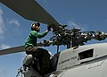 U.S. Navy Aviation Electronics Technician 3rd Class Randolph Vasquez inspects an SH-60B Seahawk helicopter assigned to Helicopter Anti-Submarine Squadron Light (HSL) 48 on the flight deck of the guided missile 120901-N-NL541-058.jpg