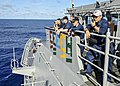U.S. Navy Capt. James T. Jones, second from right, the commanding officer of the guided missile cruiser USS Shiloh (CG 67), watches a replenishment at sea with the dry cargo ship USNS Wally Schirra (T-AKE 8) 130527-N-KB052-029.jpg