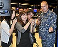U.S. Navy Gunner's Mate 1st Class David Stevens, right, shows an intern from the South Korean Parliament how to aim a simulated laser-guided 9mm Beretta pistol in the USS Missouri small-arms marksmanship 120730-N-IK959-036.jpg