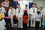 U.S. Sailors with the U.S. 7th Fleet Band's Pacific Ambassadors receive handshakes from Singaporean children after a performance at the Jamiyah Children's Home in Singapore June 11, 2013 130611-N-GR655-089.jpg