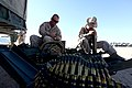 U. S. Marine Sgt. Jimmy Smalygo (left) and Pfc. Matthew Cutting (right) with Engineer Company, Combat Logistics Regiment 2, 2nd Marine Logistics Group, count and prepare ammunition for their crew serve weapon 120902-M-KS710-015.jpg