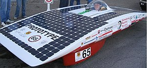 Solar Team - This is an image of the X1, the prototype solar car created by the UC Solar team for testing purposes. In this image it is being piloted by driver James Snell for the Calgary Stampede Parade in the summer of 2005.