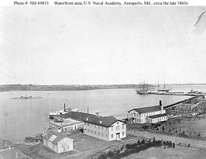 USS Santee (1855) - US Naval Academy waterfront in the late 1860s with the barrack/school ships USS Constitution and Santee tied up in the background. Other ships not identified.