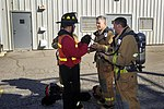 USS Dwight D. Eisenhower commanding officer receives firefighting training 140311-N-FK070-054.jpg