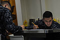 USS San Diego Sailors take advancement exam 150319-N-RC734-004.jpg