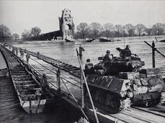 U.S. Army troops cross the Rhine on a heavy pontoon bridge, March, 1945[1]