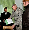 US JAG gives Prosecutor of the Abdul Basheer Yaqobi legal reference books.jpg