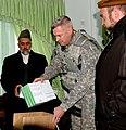 US JAG gives Prosecutor of the Abdul Basheer Yaqobi legal reference books.jpg