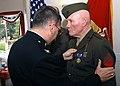 US Navy 030421-N-6901L-003 Col. Steven M. Keim pins a Purple Heart Award on the chest of World War II veteran Cpl. John Wright.jpg
