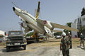 US Navy 030710-N-7611B-001 Seabees assigned to Naval Mobile Construction Battalion Twenty Six (NMCB-26) use a crane to lift an EA-3B plane from a trailer in front of Naval Station Rota, Spain's Bachelor Officer Quarters.jpg