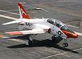 US Navy 030716-N-4757S-011 A T-45C Goshawk makes an arrested landing on the flight deck.jpg