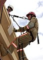 US Navy 040203-N-4614W-010 During training, Emergency Response Team (ERT) Member Aerographer's Mate 3rd Class Casey Robertson, assigned to the Meteorological and Oceanography Command, Bahrain, reaches the top of Naval Support A.jpg