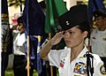 US Navy 040601-N-4995T-077 Battalion Commander Cadet Ensign Melanie Leonard, of Radford High School Junior ROTC, salutes during the parading of the colors ceremony held at the Parchee Memorial Submarine Base at this year's Memo.jpg
