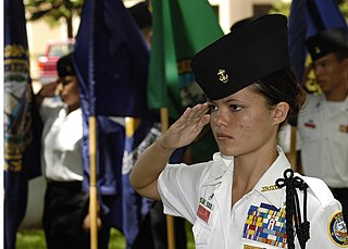 US Navy 040601-N-4995T-077 Battalion Commander Cadet Ensign Melanie Leonard, of Radford High School Junior ROTC, salutes during the parading of the colors ceremony held at the Parchee Memorial Submarine Base at this year's Memo